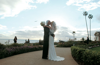 bride-and-groom-kiss-on-grounds-of-montage-laguna-beach