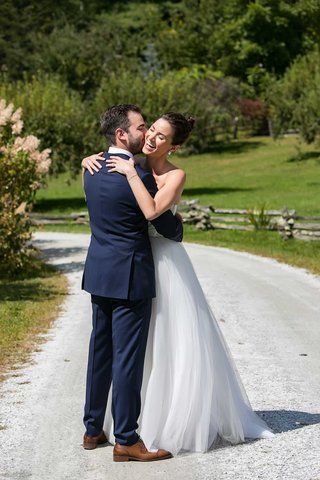 bride-in-strapless-a-line-wedding-dress-hair-up-high-bun-groom-in-navy-blue-suit-brown-dress-shoes