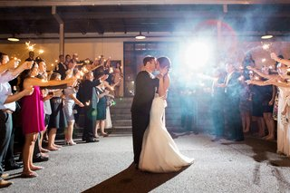 couple-kiss-with-guests-and-sparklers