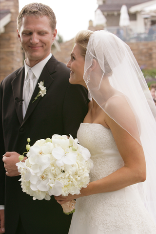 groom-in-black-suit-and-bride-in-embroidered-white-dress
