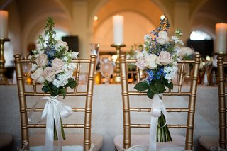 gold-chiavari-chairs-with-bouquet-tied-on-back