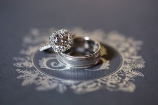 wedding-rings-engagement-ring-pave-band-halo-setting-and-mens-band-on-invite-monogram