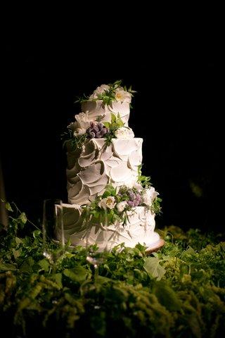 alexis-cozombolidis-and-hunter-pence-wedding-cake-white-frosting-fresh-flowers-greenery-three-layer