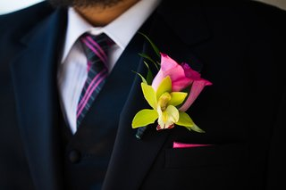 groom-with-pink-rose-and-green-cymbidium-orchid-boutonniere