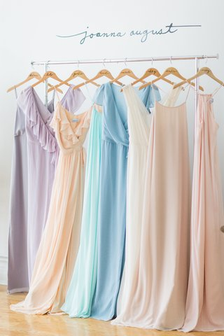 colorful-bridesmaid-dresses-on-clothing-rack-with-personalized-hangers-by-joanna-august-2016