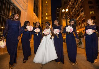 bride-in-wedding-dress-with-bridesmaids-in-long-navy-blue-dresses-with-long-sleeves-or-cap-sleeves