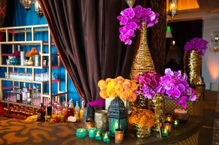 gold-textured-vases-with-hot-pink-orchids-calla-lilies-orange-chrysanthemums-colorful-lanterns
