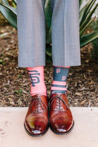 groom-in-grey-suit-brown-shoes-mismatched-san-francisco-giants-socks