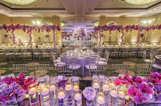 wedding-ballroom-at-four-seasons-los-angeles-with-lush-purple-and-pink-flowers