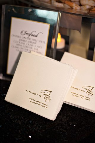 vow-renewal-wedding-anniversary-party-white-napkin-gold-foil-a-toast-to-fifty-lucky-in-love