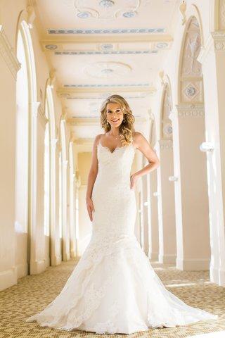 bride-in-trumpet-wedding-dress-by-ines-di-santo-sweetheart-neckline-lace-blonde-hair-down