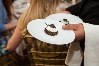 waiter-serving-caviar-cake-at-beverly-hills-bridal-shower