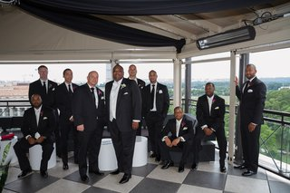 african-american-man-with-friends-in-tuxedos