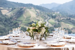 vineyard-wedding-winery-views-of-mountains-low-centerpiece-gold-plates-linens