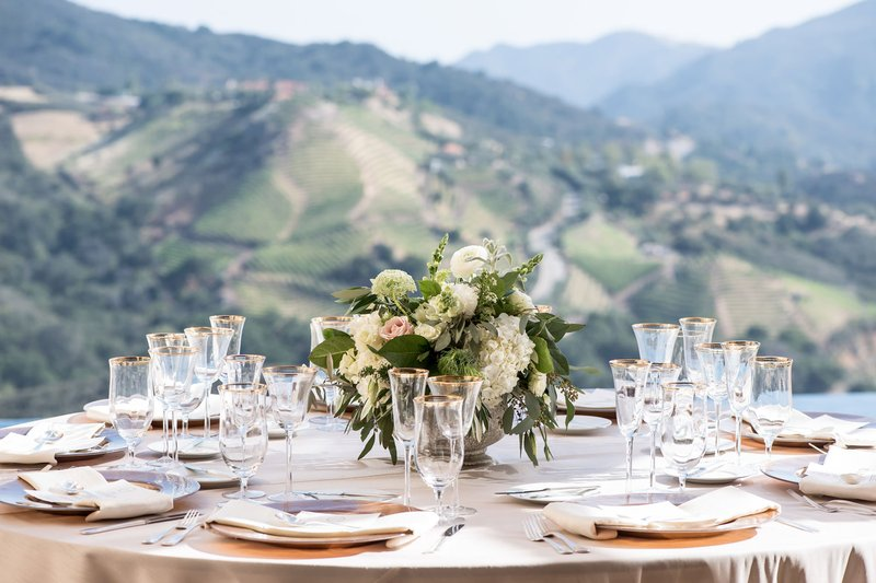 wedding reception table with low centerpiece in center malibu views
