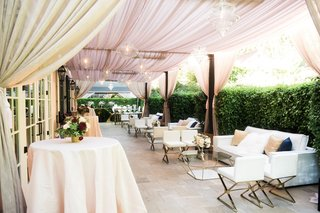 hotel-bel-air-cocktail-hour-drapery-outdoors-alfresco-terrace-white-lounge-furniture-gold-modern
