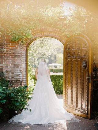 bride-in-martina-liana-a-line-gown-cathedral-veil