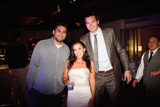 bride-in-a-strapless-vera-wang-gown-beaded-sash-with-ny-knicks-forward-louis-amundson-at-reception