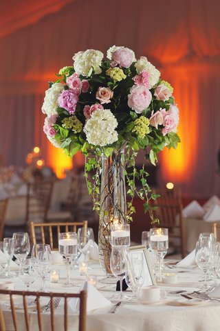 white-table-topped-with-towering-flower-arrangement