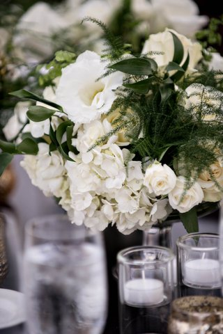 white-hydrangeas-ivory-roses-greenery-low-wedding-centerpiece-with-white-florals-and-greenery