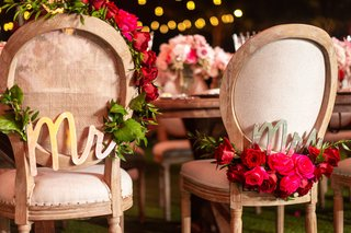 wedding-reception-wood-round-back-chair-with-garland-pink-red-rose-flowers-gold-mr-mrs-signs