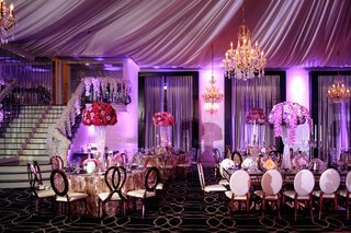 wedding-reception-designed-by-lily-v-events-bright-purple-lighting-drapery-chandelier-metallic-gold