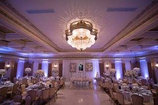 purple-uplighting-banquet-hall-wedding-reception-sweetheart-table-with-overflowing-flower-runner
