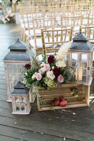 rustic-fall-ceremony-decor-with-lanterns-blush-roses-wine-red-dahlias-pampas-grass-pomegranates