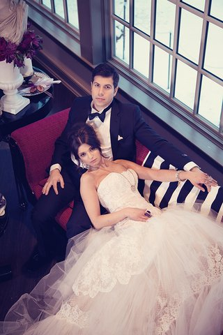 bride-in-a-strapless-gown-with-tulle-and-lace-skirt-with-groom-in-a-black-tuxedo