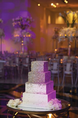 wedding cake four layer square tier sprinkle silver gold design modern on mirror table
