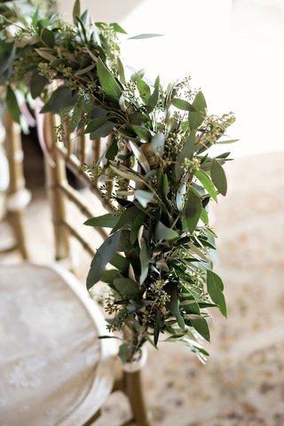 eucalyptus-garland-on-back-of-gold-chiavari-chair-wedding-sweetheart-table