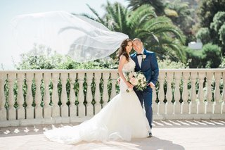 wedding-couple-bride-and-groom-trumpet-wedding-dress-groom-in-navy-blue-bow-tie-bel-air-bay-club