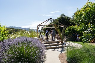 iko-space-used-as-chuppah-altar-for-wedding-geometric-terrarium-similar-look-outdoor-ceremony