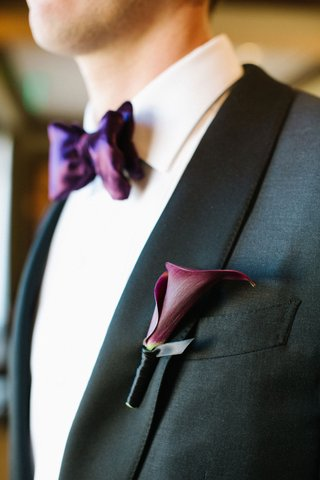 wedding-attire-groom-suit-with-calla-lily-boutonniere-night-cap-and-purple-bow-tie-white-shirt-black