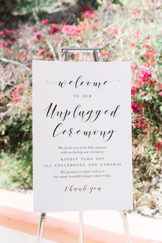 white-and-black-wedding-signage-welcome-to-our-unplugged-ceremony-turn-off-all-cell-phones-cameras