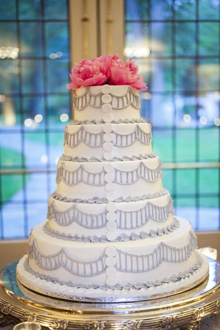 white-wedding-cake-with-design-in-light-purple-piping-buttons-hot-pink-peonies