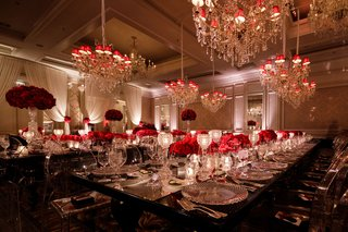 ballroom-wedding-reception-black-red-white-silver-color-palette-chandeliers-red-shades-mirror-runner