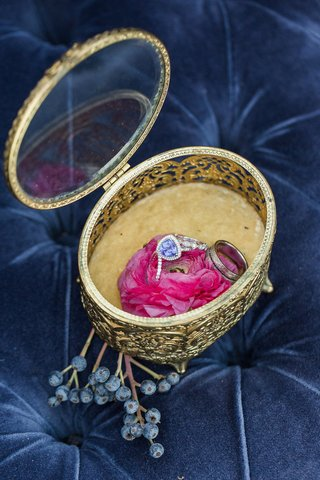 unique-engagement-ring-and-wedding-rings-held-in-an-ornate-gold-box