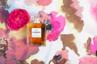 bottle-of-chanel-no-5-five-on-top-of-pink-floral-table-linen