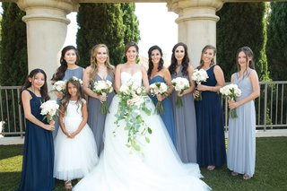 bride-in-vera-wang-ball-gown-mismatched-bridesmaids-in-blue-shades-junior-bridesmaid-flower-girl