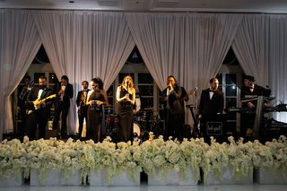 bob-gail-music-and-entertainment-performing-live-band-white-flowers-stage-drapes-four-seasons