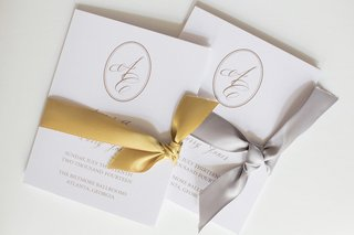 wedding-ceremony-programs-with-monogram-and-gold-silver-ribbon