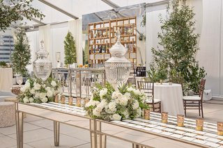 mirror-table-with-white-and-green-flower-arrangements-escort-cards-candles-cocktail-hour