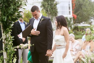 groom-in-armani-emotional-while-exchanging-vows-with-bride-in-monique-lhuillier-crop-top-gown