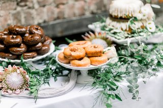 wedding-dessert-table-with-protea-blooms-donuts-nothing-bundt-cakes