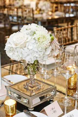 rose-hydrangeas-and-mum-centerpiece-in-glass-vase-on-a-mirrored-base