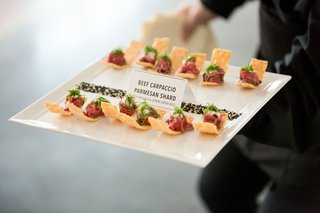 beef-carpaccio-on-a-parmesan-shard-with-arugula-and-lemon-caper-aioli-hors-doeuvre-appetizer-event