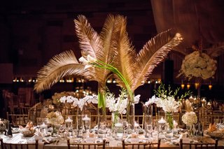 wedding-reception-centerpiece-white-flowers-gold-sago-palm-leaves-greenery-long-rectangular-table