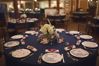 blue-table-with-lobster-details-and-buoy-centerpiece