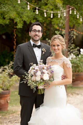 man-in-tuxedo-and-glasses-and-woman-in-bridal-gown